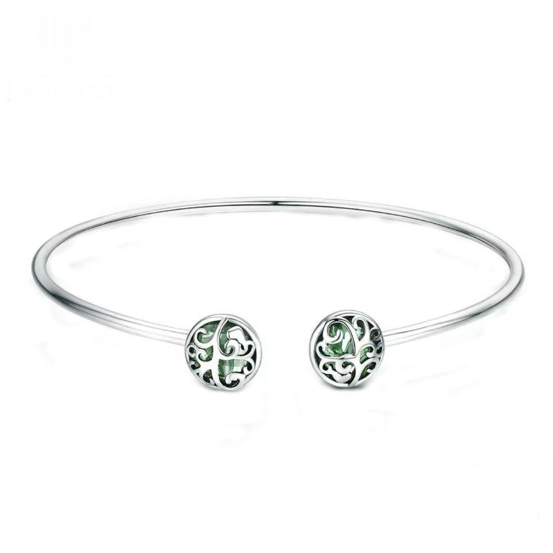 Pulsera abierta con charms árbol de la vida fijos en plata de primera ley y cristal verde. Compatible Pandora.