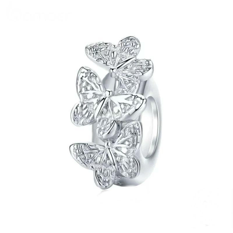 Charm separador mariposa con circonitas cubicas transparentes en plata de primera ley. Compatible con pulseras Pandora.
